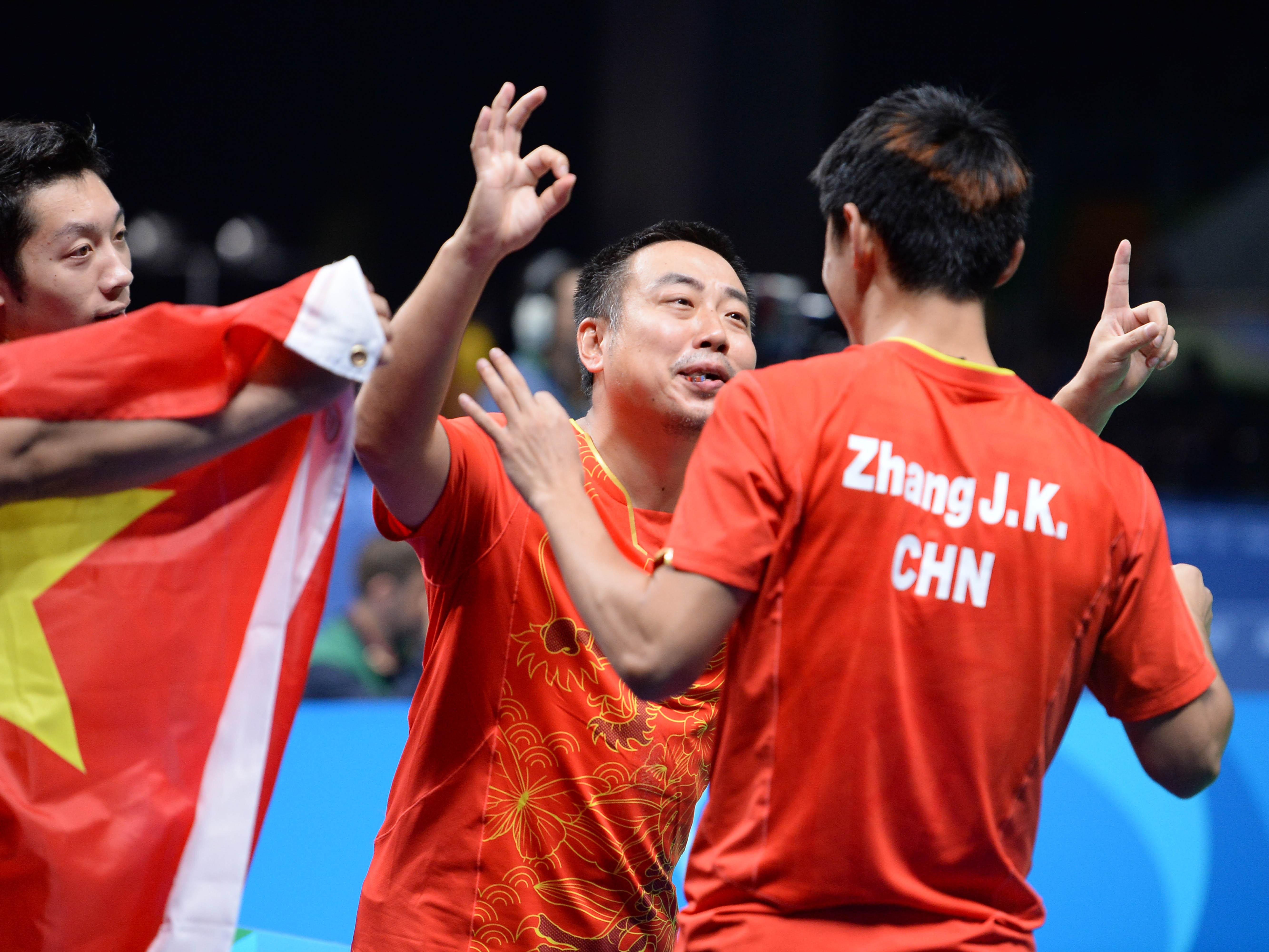 China's men's coach Liu Guoliang (central) celebrates with team members Zhang Jike and Xu Xin (Photo: Konno Noboru)