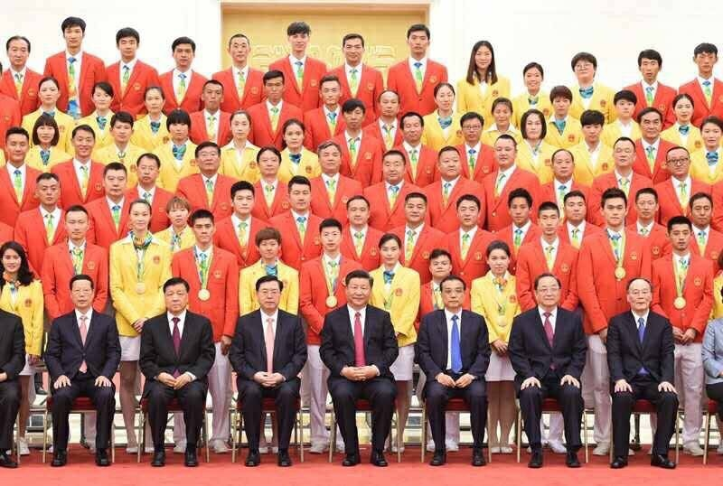 The Chinese Olympic delegation with Chinese President Xi Jinping.