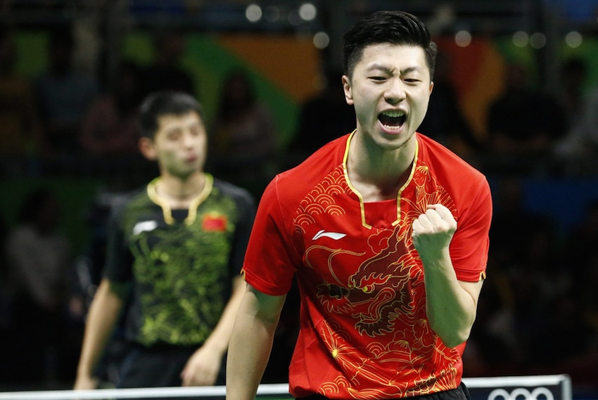 Ma Long in clenched fist against Zhang Jike in the 2016 Rio Olympic Games Men's Singles finals. (Photo from China Youth)
