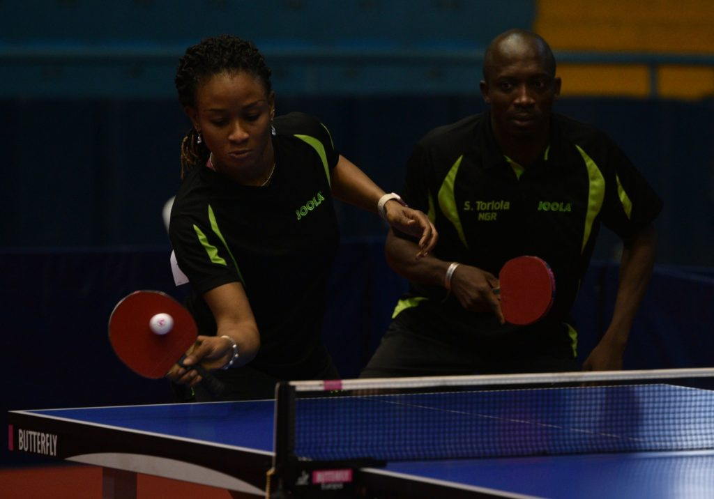Segun Toriola and Olufunke Oshonaike in action during mixed doubles semi finals. Photo By: Adebola Adenusi
